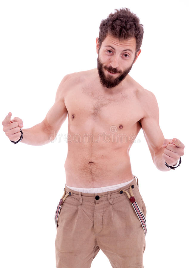 Man with beard posing. Naked to the waist in front of the camera stock image