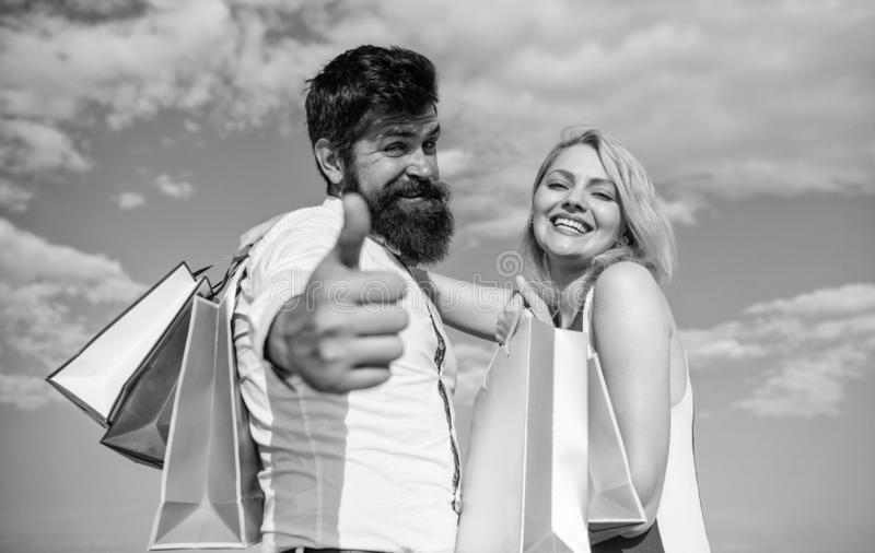 Man with beard shows thumb up gesture. Advice to buy now. Happy family shoppers. Couple in love recommend shopping. Summer sale discount season. Couple with stock photography