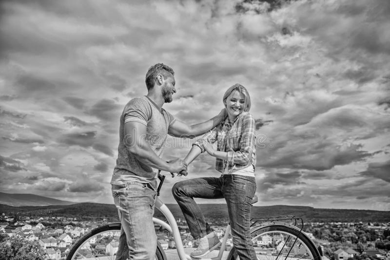 Man with beard and shy blonde lady on first date. How to meet girls while riding bike. Picking up girl. Couple just meet stock images