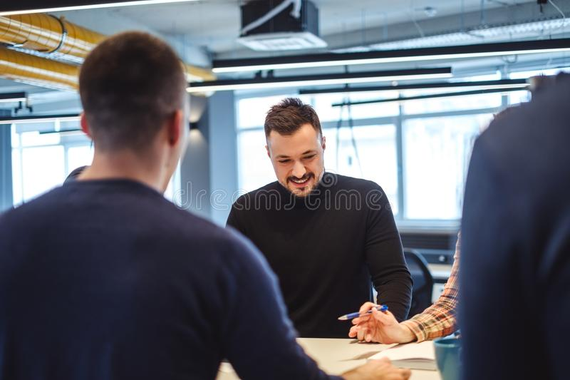 Man with beard smiling at the office meeting stock photos