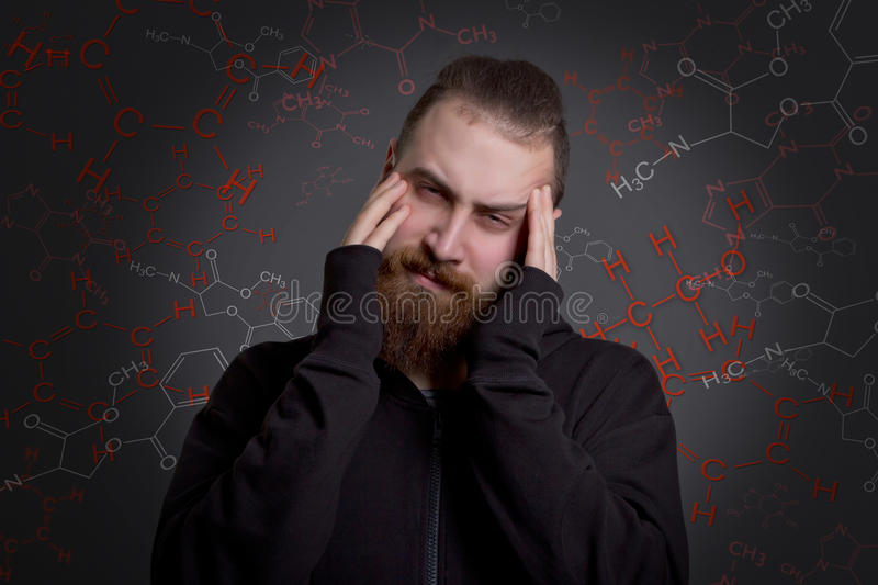 Man with a beard is suffering from drug addiction royalty free stock images