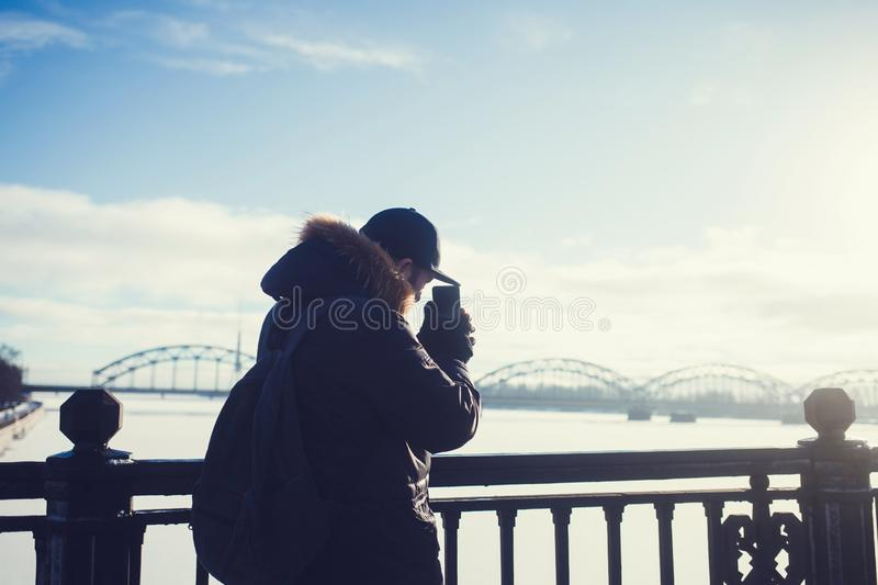 Man with a beard taking pictures royalty free stock image