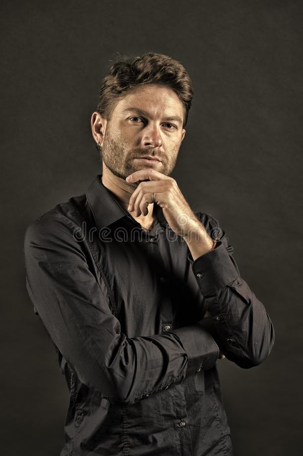 Man with beard on thinking face. Bearded man pose in shirt. Skincare and barber salon. Fashion model on dark background. Fashion style and trend, vintage stock photos