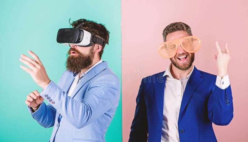 Man with beard in VR glasses and louvered plastic accessory. Guy interact in virtual reality. Hipster exploring virtual royalty free stock photo