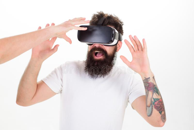 Man with beard in VR glasses, white background. Hipster use modern technologies for entertainment. Guy with head mounted. Display interact with hand in virtual royalty free stock photography