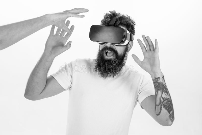 Man with beard in VR glasses, white background. Virtual reality concept. Guy with head mounted display interact with. Hand in virtual reality. Hipster use royalty free stock photo