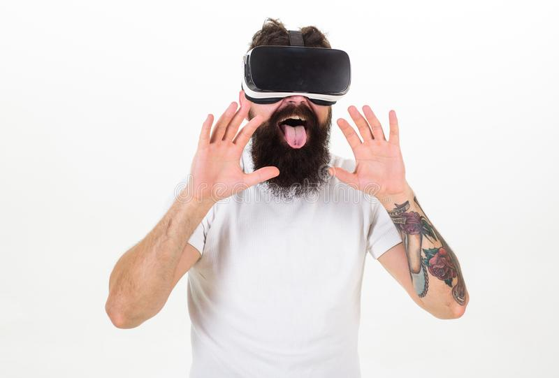 Man with beard in VR glasses, white background. Virtual sex concept. Guy with head mounted display having sex in virtual. Reality. Hipster licking with tongue stock photos