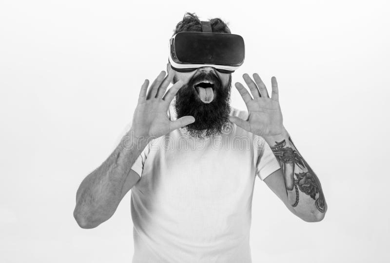 Man with beard in VR glasses, white background. Virtual sex concept. Guy with head mounted display having sex in virtual. Reality. Hipster licking with tongue stock photography
