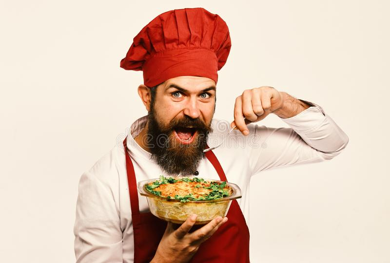 Man with beard on white background. Cook with cheerful face royalty free stock photo
