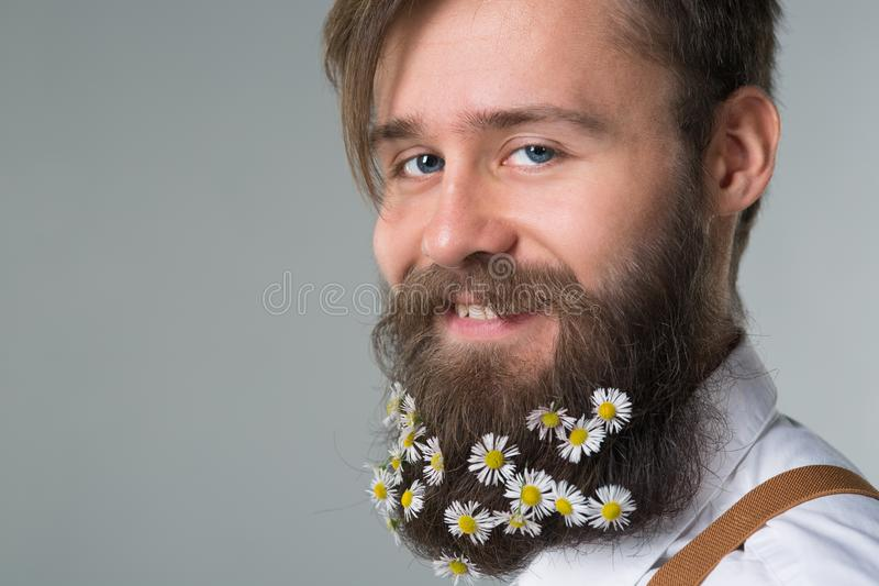 Man with beard in white shirt and suspenders stock photo