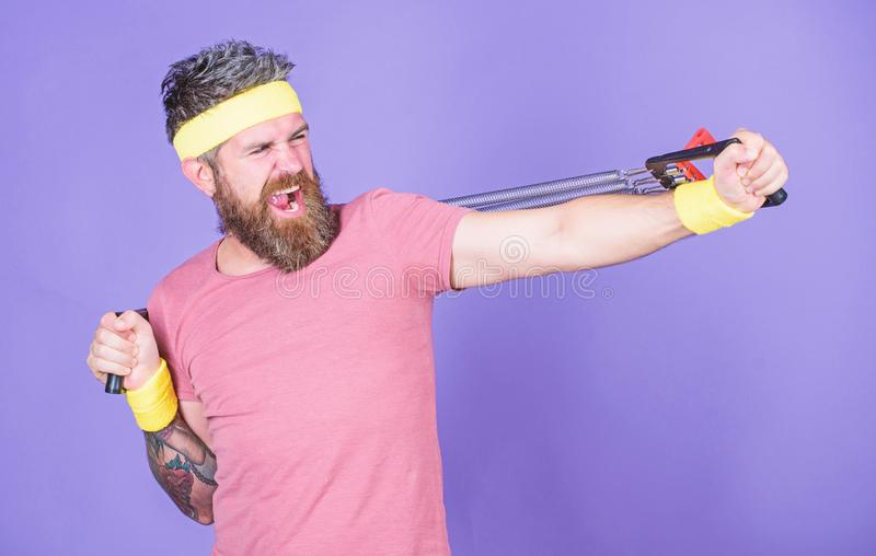 Man bearded athlete exercising with expander equipment. Try stretching exercise. Athlete sport instructor. Lets stretch stock images