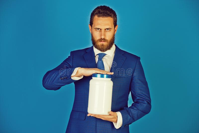 Man or bearded businessman with plastic jar on blue background stock images