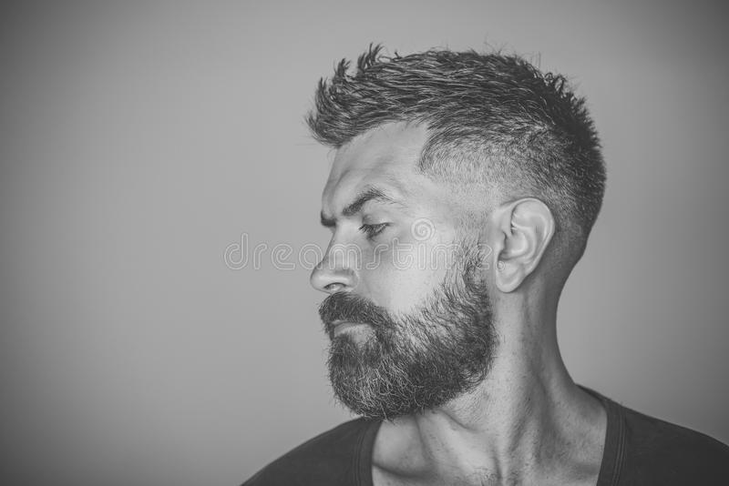 Man with bearded face profile and stylish hair stock photo