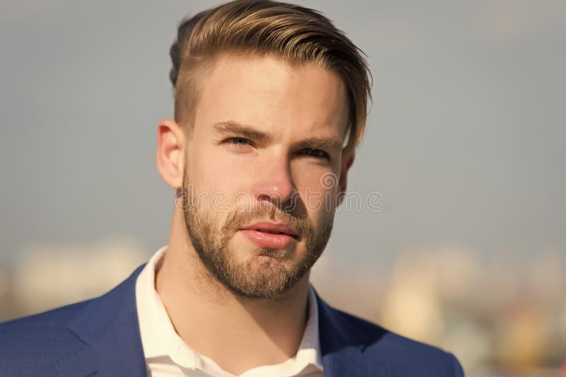 Man with bearded face on sunny outdoor. Businessman with stylish haircut on blurred sky. Business fashion, style and. Businessman. Man with bearded face on sunny royalty free stock photography