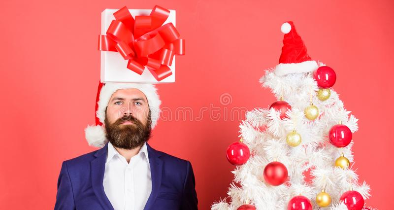 Man bearded formal suit carry gift box on head. Christmas present idea concept. Thinking about gift ideas. Come up with. Good present. Gift service. Head stock photos