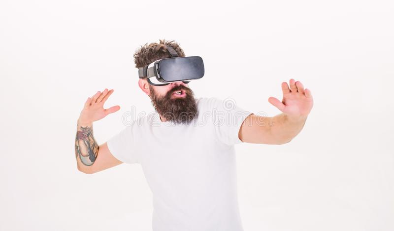 Hipster play virtual sport game. Man bearded gamer VR glasses white background. Virtual reality game concept. Cyber. Man bearded gamer VR glasses white royalty free stock photography