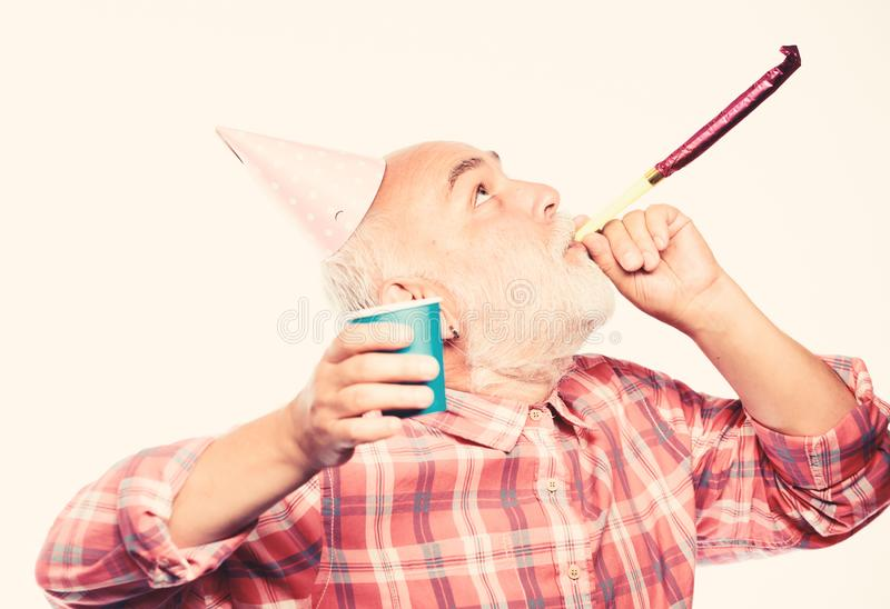 Man bearded grandpa with birthday cap and drink cup. Birthday crazy party. Ideas seniors birthday celebrations stock image