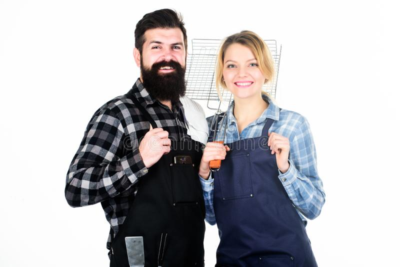 Man bearded guy and girl ready for barbecue white background. Backyard barbecue party. Family cooking grilled food stock photography