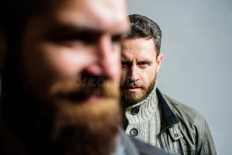 Man bearded guy stand behind back of friend hipster. True friend always near. Someone behind you. Stand beside you. Friendship trust and support. Trustful royalty free stock photography
