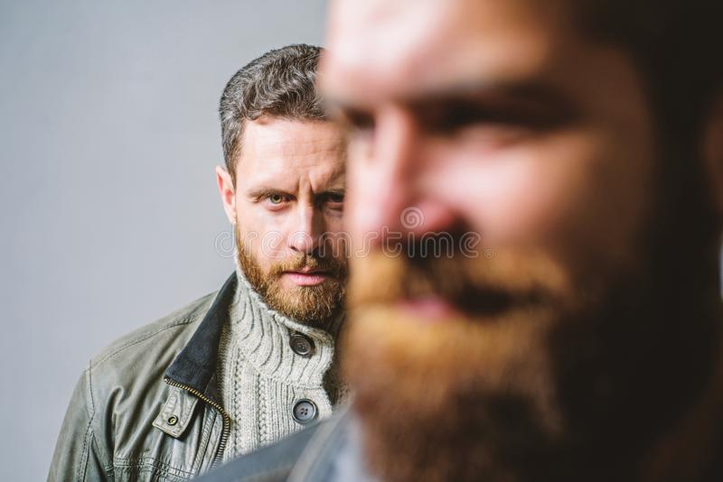 Man bearded guy stand behind back of friend hipster. True friend always near. Someone behind you. Stand beside you stock photo