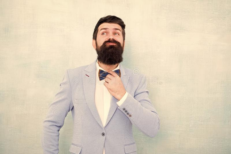Man bearded hipster formal suit with bow tie. Wedding fashion. Formal style perfect outfit. Impeccable groom. Tips for royalty free stock image