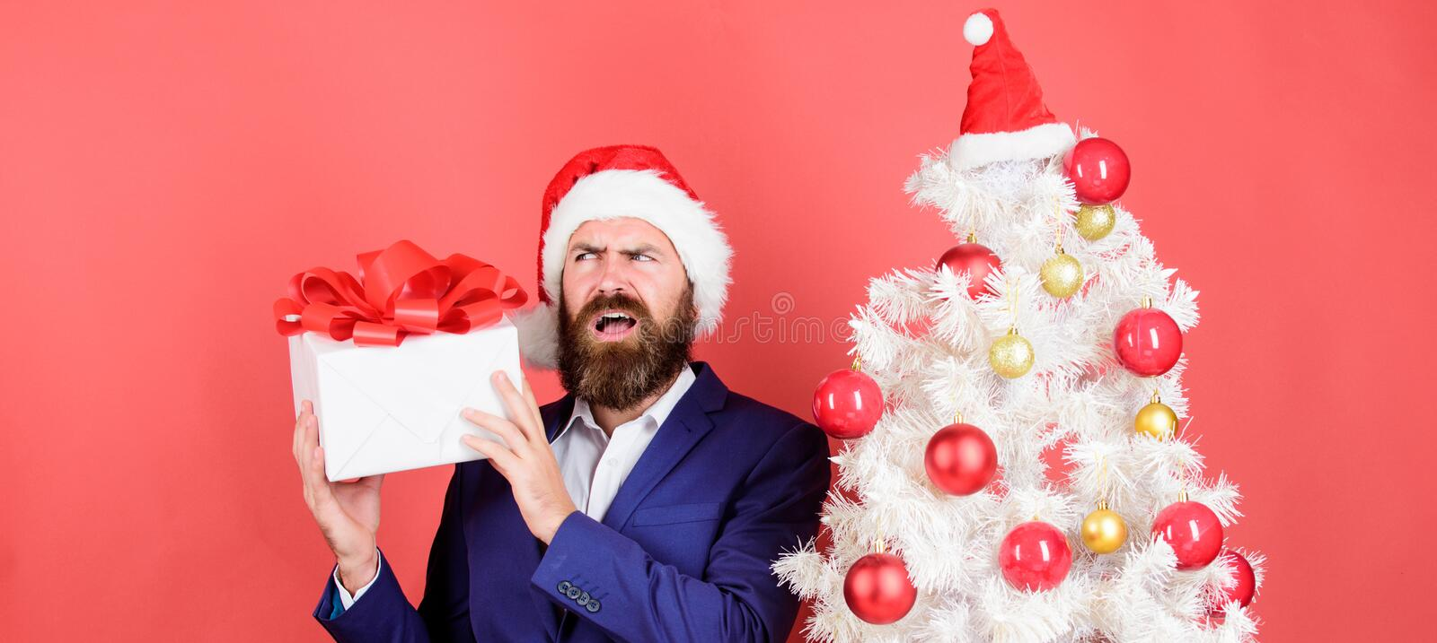 Man bearded hipster formal suit christmas tree hold gift box. Sharing kindness and happiness. Prepare gifts for everyone. Gifts shop. Christmas gifts. Winter royalty free stock photos
