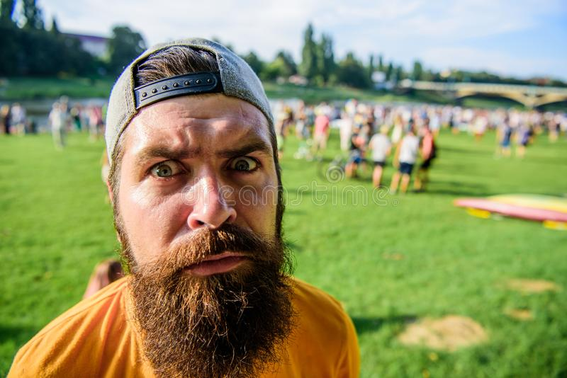 Man bearded hipster in front of crowd. Book ticket now. Open air concert. City day. Music festival. Entertainment. Concept. Visit summer festival. Guy celebrate stock images
