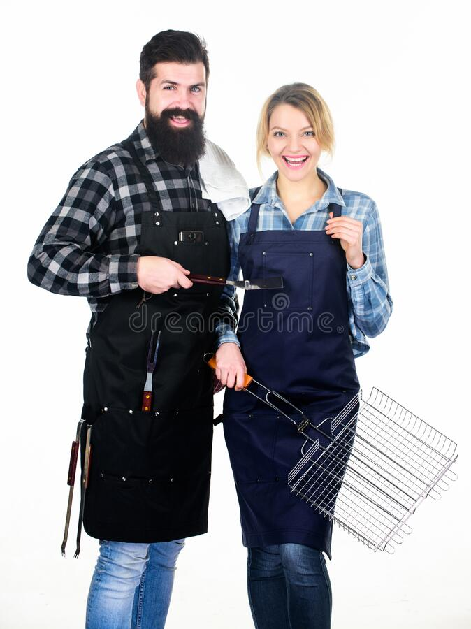 Man bearded hipster and girl ready for barbecue white background. Backyard barbecue party. Family bbq ideas. Couple in. Love getting ready for barbecue. Picnic stock images