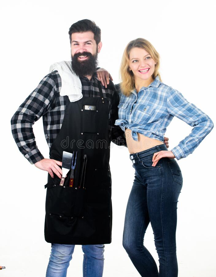 Man bearded hipster and girl ready for barbecue white background. Backyard barbecue party. Family bbq ideas. Delicious. Grilled recipes. Couple in love getting royalty free stock photo