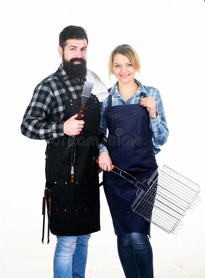 Man bearded hipster and girl ready for barbecue white background. Summertime leisure. Backyard barbecue party. Family. Bbq ideas. Couple in love getting ready royalty free stock photography