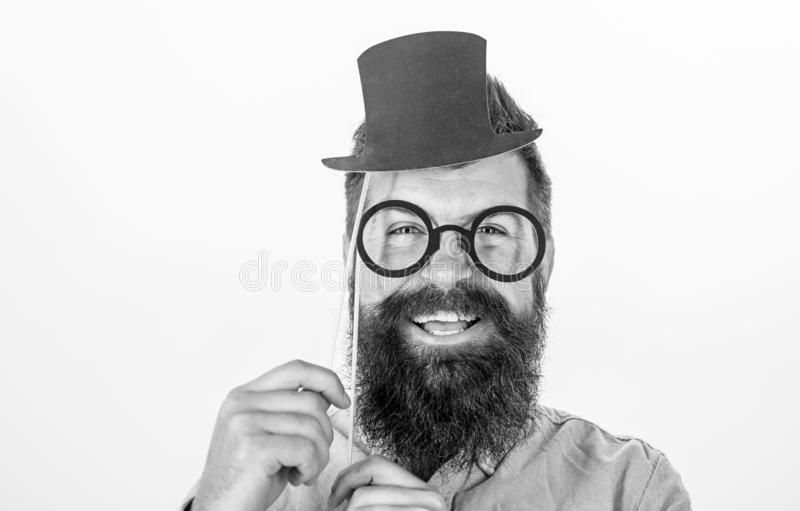 Man bearded hipster hold cardboard top hat and eyeglasses to look smarter white background. Dress affects how people see. You. Guaranteed ways appear smarter royalty free stock photo