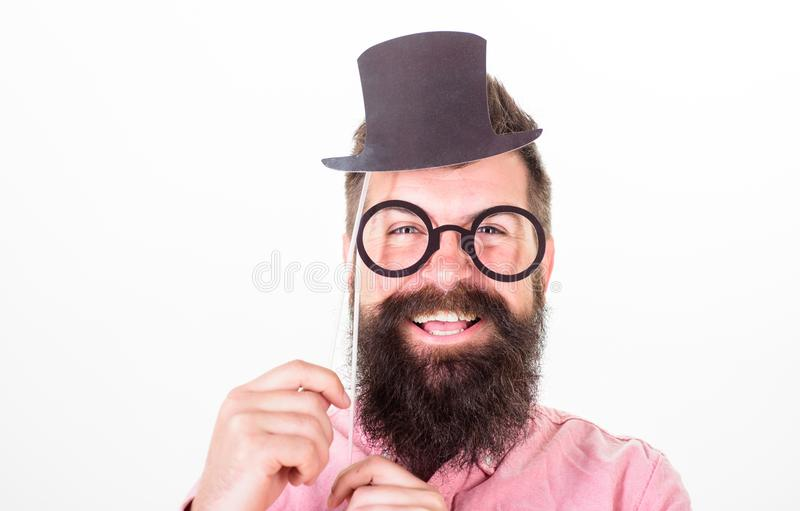 Man bearded hipster hold cardboard top hat and eyeglasses to look smarter white background. Dress affects how people see. You. Guaranteed ways appear smarter royalty free stock photos