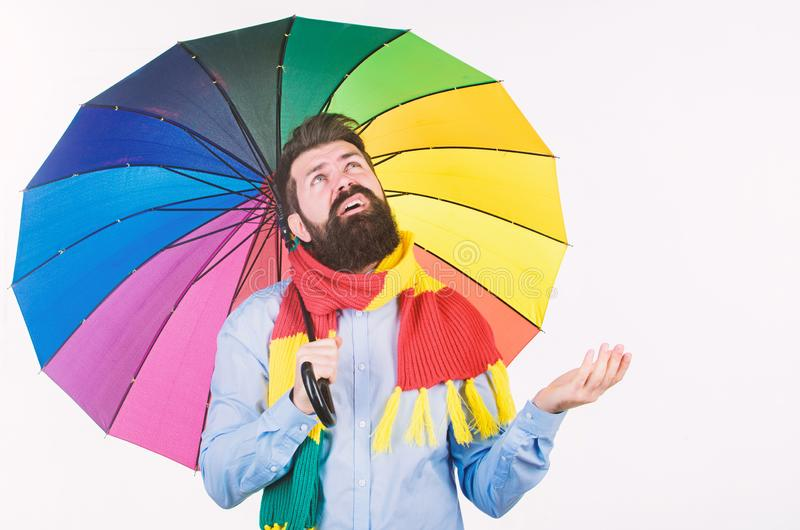 Man bearded hipster hold colorful umbrella. It seems to be raining. Rainy days can be tough to get through. Prepared for. Rainy day. Carefree and positive stock photo