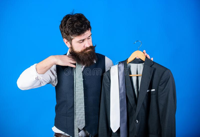 Man bearded hipster hold neckties and formal suit. Perfect necktie. Shopping concept. Stylist advice. Difficulty royalty free stock photos
