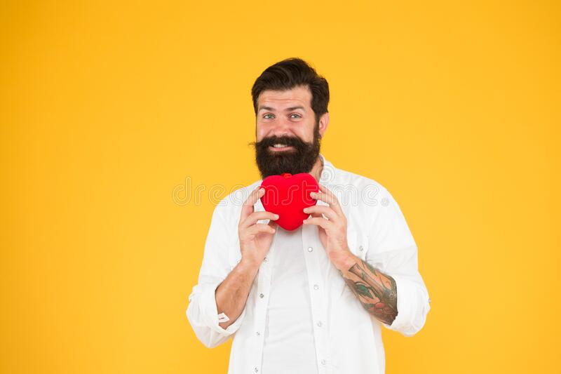 Man bearded hipster hold red heart. Health care concept. Check helps understand risk factors for heart disease. Doing. More physical activity quitting smoking royalty free stock image