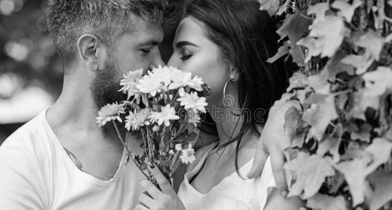 Man bearded hipster kisses girlfriend. Secret romantic kiss. Love romantic feelings. Moment of intimacy. Couple in love stock photography
