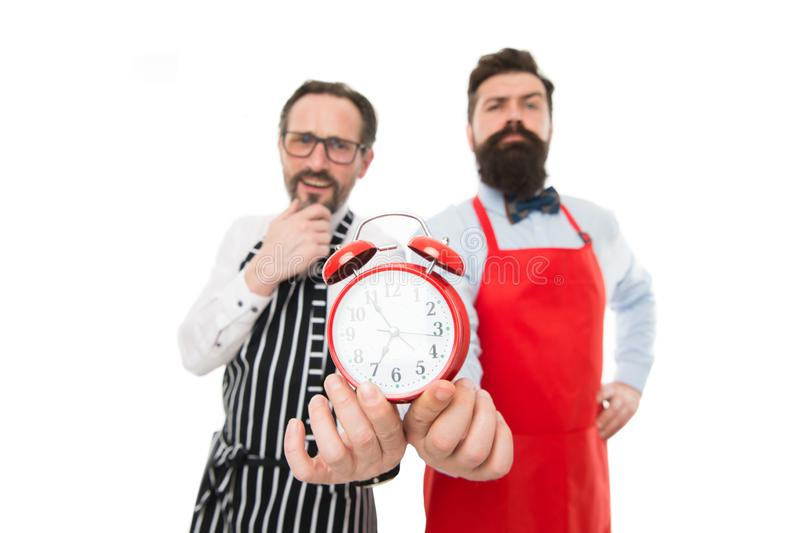 Man bearded hipster and mature chef apron white background. Working hours and lunch break. Lack of time. Check what time royalty free stock photo