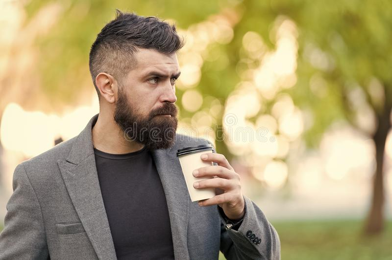 Man bearded hipster prefer coffee take away. Businessman drink coffee outdoors. Reloading energy. Relaxing coffee break. Hipster hold paper coffee cup and stock photos