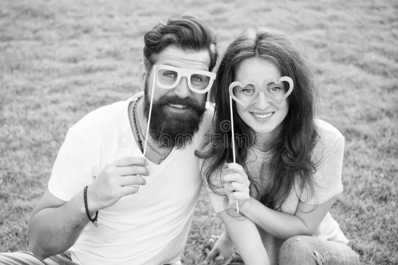 Man bearded hipster and pretty woman in love. Summer vacation. Happy together. Couple in love cheerful youth booth props royalty free stock images