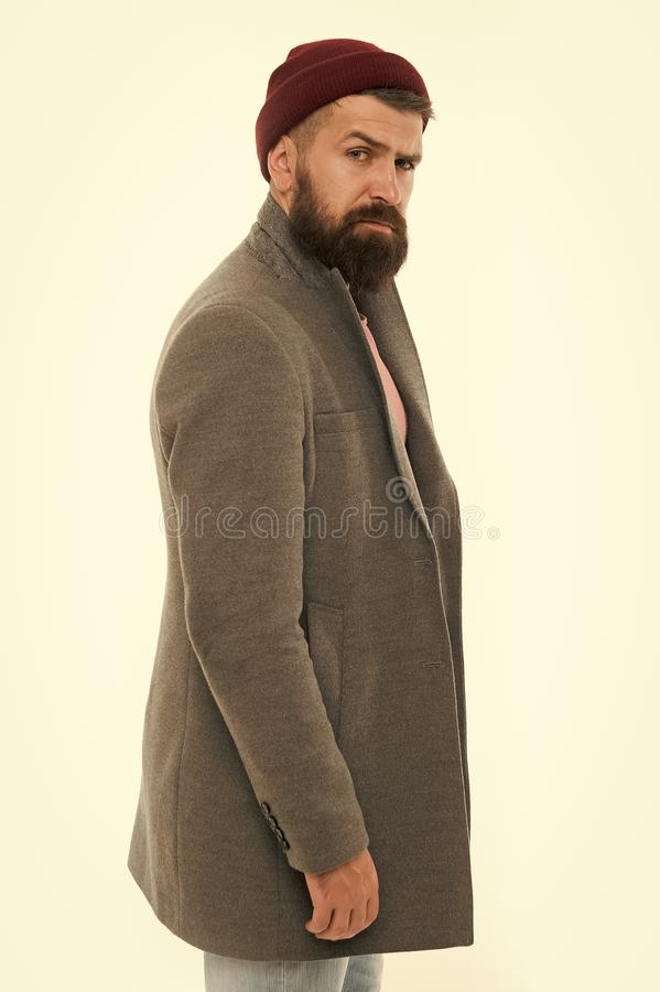 Man bearded hipster stylish fashionable coat and hat. Stylish outfit hat accessory. Pick matching clothes. Find outfit. Style you feel comfortable. Stylish royalty free stock image