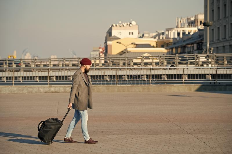 Man bearded hipster travel with big luggage bag on wheels. Let travel begin. Traveler with suitcase arrive to airport. Railway station. Hipster ready enjoy stock images