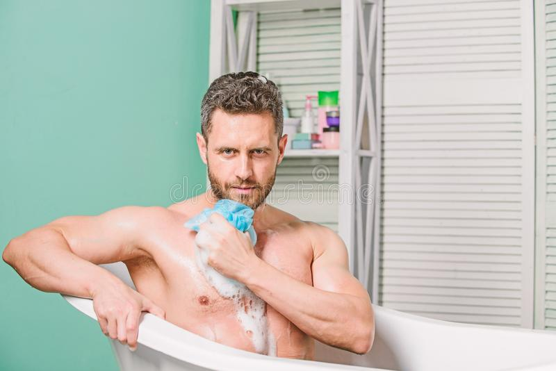Man bearded hipster use sponge cleaning skin. Personal hygiene. Take care hygiene. Personal grooming is cleaning parts stock photography