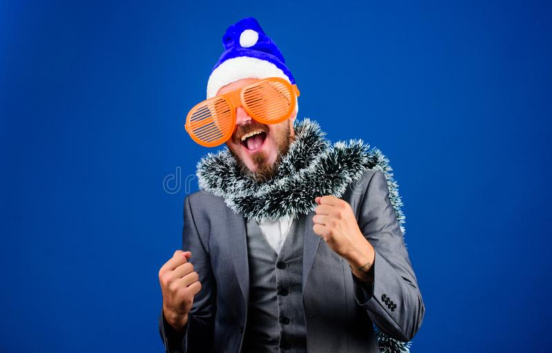 Man bearded hipster wear santa hat and funny sunglasses. Christmas party organisers. Guy tinsel ready celebrate new year stock photography