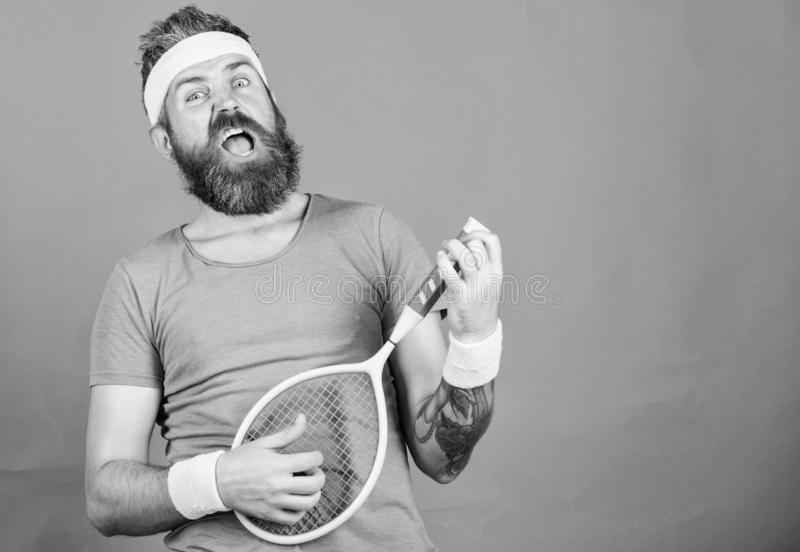 Man bearded hipster wear sport outfit. Having fun. Tennis active leisure. Athlete hipster hold tennis racket in hand red. Background. Tennis player vintage royalty free stock images
