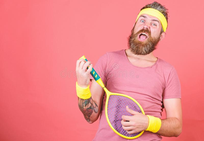 Man bearded hipster wear sport outfit. Having fun. Tennis active leisure. Athlete hipster hold tennis racket in hand red royalty free stock photos