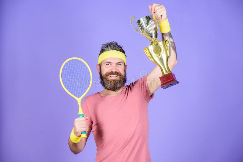 Man bearded hipster wear sport outfit. Success and achievement. Win tennis game. Tennis match winner. Achieved top. Tennis player win championship. Athlete royalty free stock images