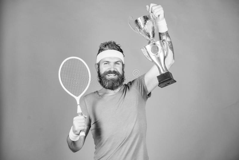 Man bearded hipster wear sport outfit. Success and achievement. Win tennis game. Tennis match winner. Achieved top. Tennis player win championship. Athlete stock photos