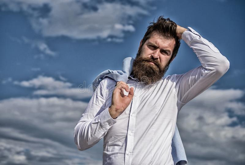 Man bearded hipster white formal clothes looks sharp sky background. Fancy groom. Hipster with beard and mustache looks stock photos