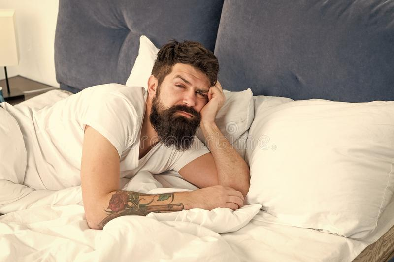 Man bearded hipster woke up too early and feels sleepy and tired. Early to get up. Keep you wide awake in the early. Morning hours. Insomnia and sleep problems royalty free stock images