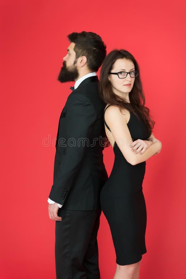 Man bearded hipster and woman in formal dress red background. Formal fashion and elegant clothes. Luxury fashion stock photos